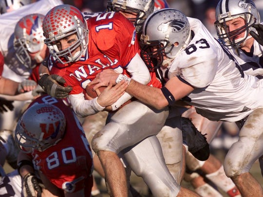 Wall quarterback Brett Burke (15) runs the ball against Middletown South, as Wall won its last state sectional title in 2002.