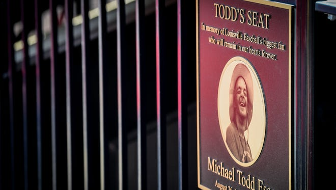 A plaque remembering Louisville fan Todd Esser along the first base stands during the game between Louisville and Virginia at Jim Patterson Field on the campus of The University of Louisville, in Louisville, Ky, April 21, 2018