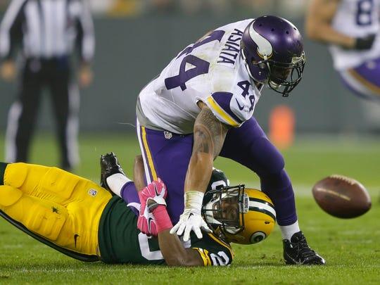 Green Bay Packers cornerback Casey Hayward breaks up a pass intended for Minnesota Vikings running back Matt Asiata in the second quarter.