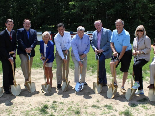 Wielding ceremonial shovels at a June 28 groundbreaking ceremony for a new synthetic turf field at the Polo Grounds in Bernardsville are (from left) Councilman Michael dePoortere, Councilman Michael Sullivan, Councilman Jeff DeLeo, Somerset County Freeholder Patricia Walsh, Freeholder Mark Caliguire, Freeholder Director Peter S. Palmer, Mayor Kevin Sooy, Councilman Peter Birnbaum, Borough Clerk Sandra Jones and Borough Administrator Ralph Maresca.
