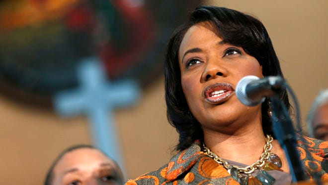 Bernice King speaks during a news conference at historic Ebenezer Baptist Church where her father Martin Luther King Jr. preached, Thursday, Feb. 6, 2014, in Atlanta.  King is in a legal battle with her brothers over her father's Bible and Nobel Peace Prize medal.
