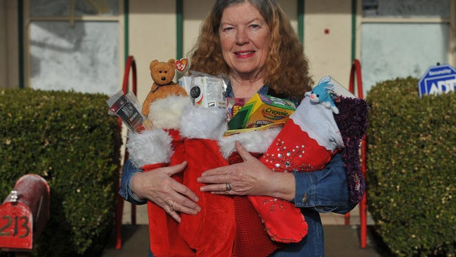 "Volunteer Kathleen Dowling is known as ""The Stocking Lady"" at the Visalia Emergency Aid Council on Nov. 25."