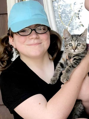 Gracie McCormick of Bronson loves her new kitten, Mabel, which was rescued by a Sturgis woman.
