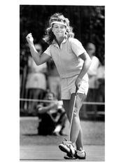 Judy Dickinson celebrates a birdie putt during her