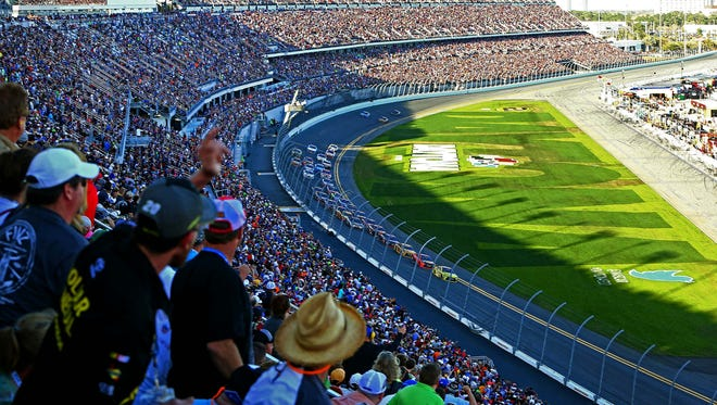 Feb 21, 2016; Daytona Beach, FL, USA; Fans cheer during the last lap of the Daytona 500 at Daytona International Speedway.