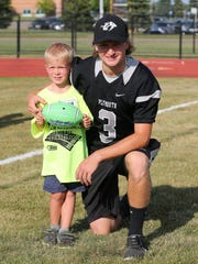 Buddies throughout the evening during 'Sunshine's' clinic were Reid Fox (left) and Plymouth player Matthew Barno.