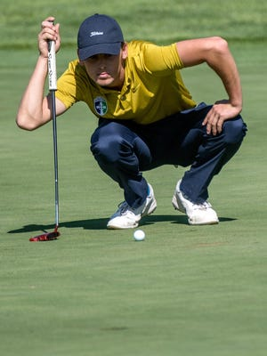 Peoria Notre Dame's Mikey Wales lines up his putt on No. 4 during the Class 2A Richwoods Regional on Monday, Oct. 7, 2019 at Kellogg Golf Course in Peoria.