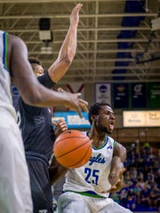 """FGCU All-ASUN senior forward Marc-Eddy Norelia made his return at Kennesaw State after missing five games for """"personal reasons."""" Norelia, whose passing has improved as evidenced by this assist against Binghamton, led the Eagles with 21 points in Thursday's 78-75 win."""