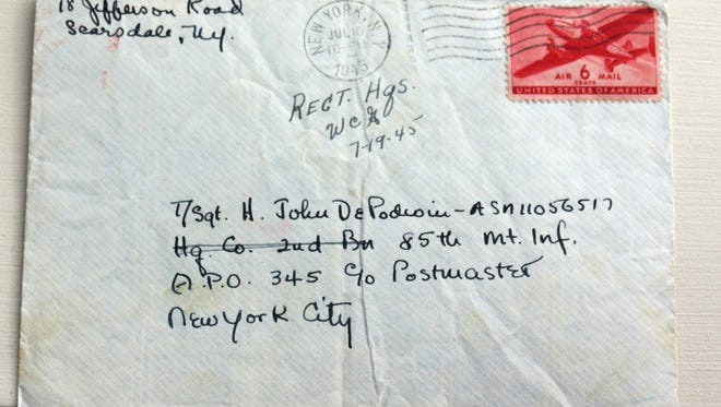 Carolyn DePodwin, 94, wrote this letter to her husband, Horace, during World War II. unaware her soldier husband had saved it. the letter traveled to Australia, hidden in a book, before recently making its way back to her.