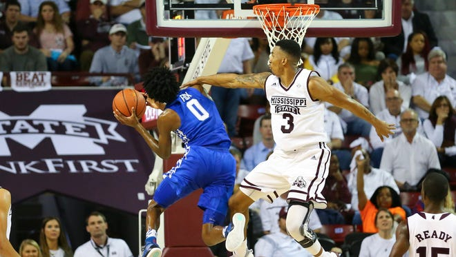 Kentucky Wildcats guard De'Aaron Fox (0) shoots the ball and is fouled by Mississippi State Bulldogs guard Xavian Stapleton (3) during the second half at Humphrey Coliseum. The Wildcats won 88-81.