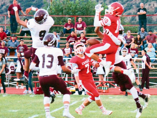Danny Udero/Sun-News: Cobre's Robert Rodriguez was harrased all night by the Ysleta secondary, but he managed to make some great catches to help the Indians come back and make it a game.