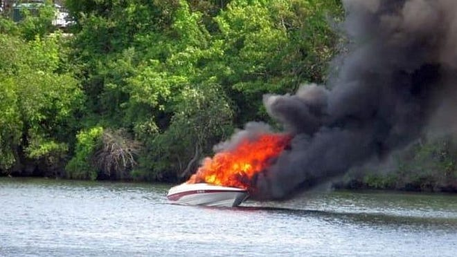 A powerboat is engulfed in flames on Lake Quinsigamond on Saturday.