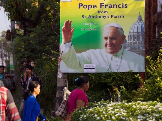 Ethnic Kachin Christians arrive at St. Anthony's Catholic