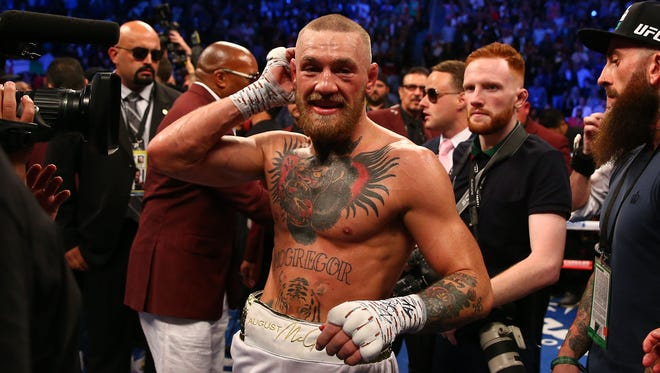 Conor McGregor reacts following his loss in the tenth round by TKO to Floyd Mayweather Jr. at T-Mobile Arena.