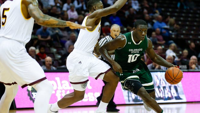CSU's Che Bob drives past Missouri State's Reggie Scurry during a game Tuesday night at Hammons Arena in Springfield, Mo.  The Rams (3-4), whose nonconference schedule has been rated the most difficult in the Mountain West, will play a home game Saturday against the University of Colorado.