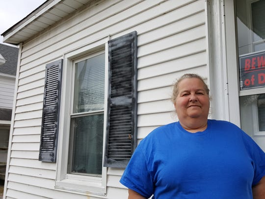 Lisa Hawkins, formerly homeless, now spends time helping other homeless people in any way she can.
