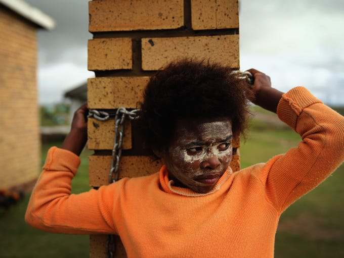 QUNU, SOUTH AFRICA - DECEMBER 12:  A Xhosa girl stands outside her home overlooking Qunu as preparations continue ahead of the funeral of former South African President Nelson Mandela on December 12, 2013 in Qunu, South Africa. Mr Mandela passed away on the evening of December 5, 2013 at his home in Houghton at the age of 95. Mandela became South Africa's first black president in 1994 after spending 27 years in jail for his activism against apartheid in a racially-divided South Africa.  (Photo by Dan Kitwood/Getty Images)