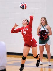 Wylie's Bailey Ann Toliver (16) serves for the South during the Big Country FCA All-Star volleyball game.