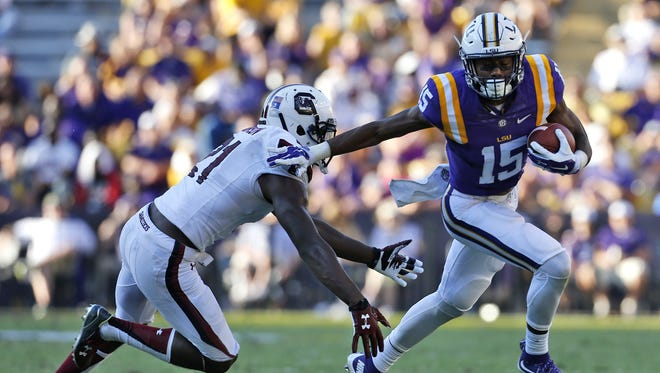 LSU wide receiver Malachi Dupre (15) runs past South Carolina safety Isaiah Johnson (21) during the second half of an NCAA college football game in Baton Rouge, La., Saturday, Oct. 10, 2015. LSU won 45-24. (AP Photo/Jonathan Bachman)