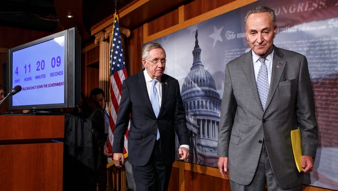 Senate Majority Leader Harry Reid of Nev., left, follows Sen. Charles Schumer, D-N.Y., right, the Democratic Policy Committee chairman, after a news conference on Capitol Hill in Washington, Thursday, Sept. 26, 2013, after blaming conservative Republicans for holding up a stopgap spending bill to keep the government running.