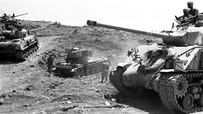 Israeli tanks advance through difficult hilly terrain on the Golan heights during the Six-Day Arab-Israeli war on June 10, 1967.