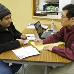 United Way volunteer Eric Lin prepares Luis Sanchez's taxes Thursday, February 5, 2015, at the Salvation Army, 1110 Union Street in Lafayette.
