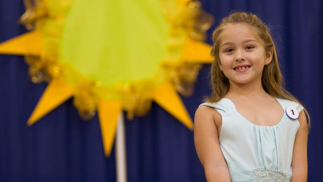 Kaylee Laman Mayfield takes the stage during the 2014 West Tennessee State Fair Special Needs Pageant on Sunday.