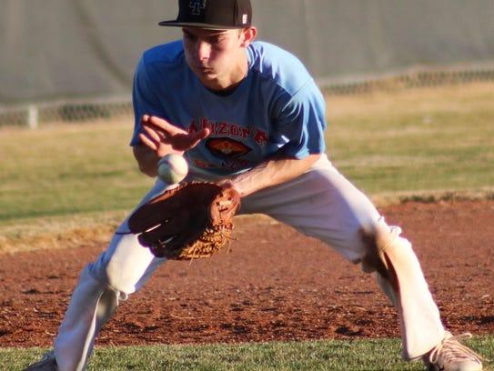 Alamogordo third baseman Dylan McGinn watches a ball