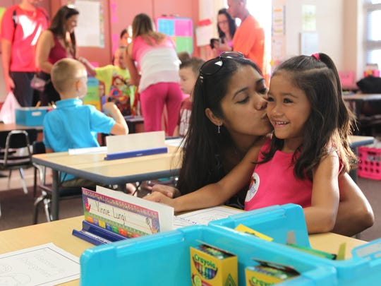 Bang Lake kisses daughter, Kailyn, 5, before leaving her kindergarten class Monday, Aug. 24, at Three Oaks Elementary School in Fort Myers.