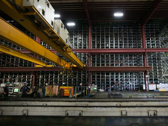 Cranes are used to access large storage spaces at Klein Steel in Rochester. The company said the trade war with China has led to uncertainty for its business.