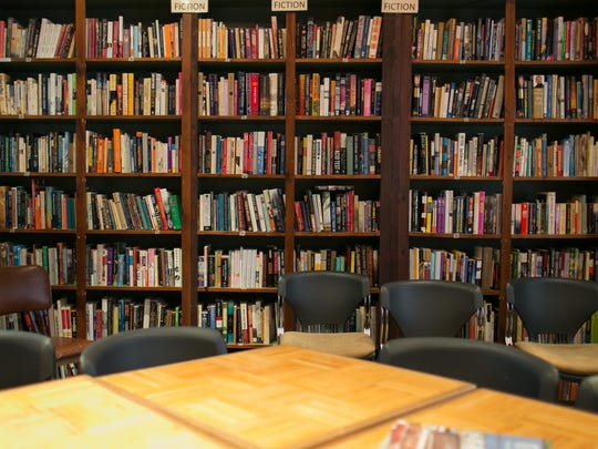 A wall of books fill the front room at Writers & Books