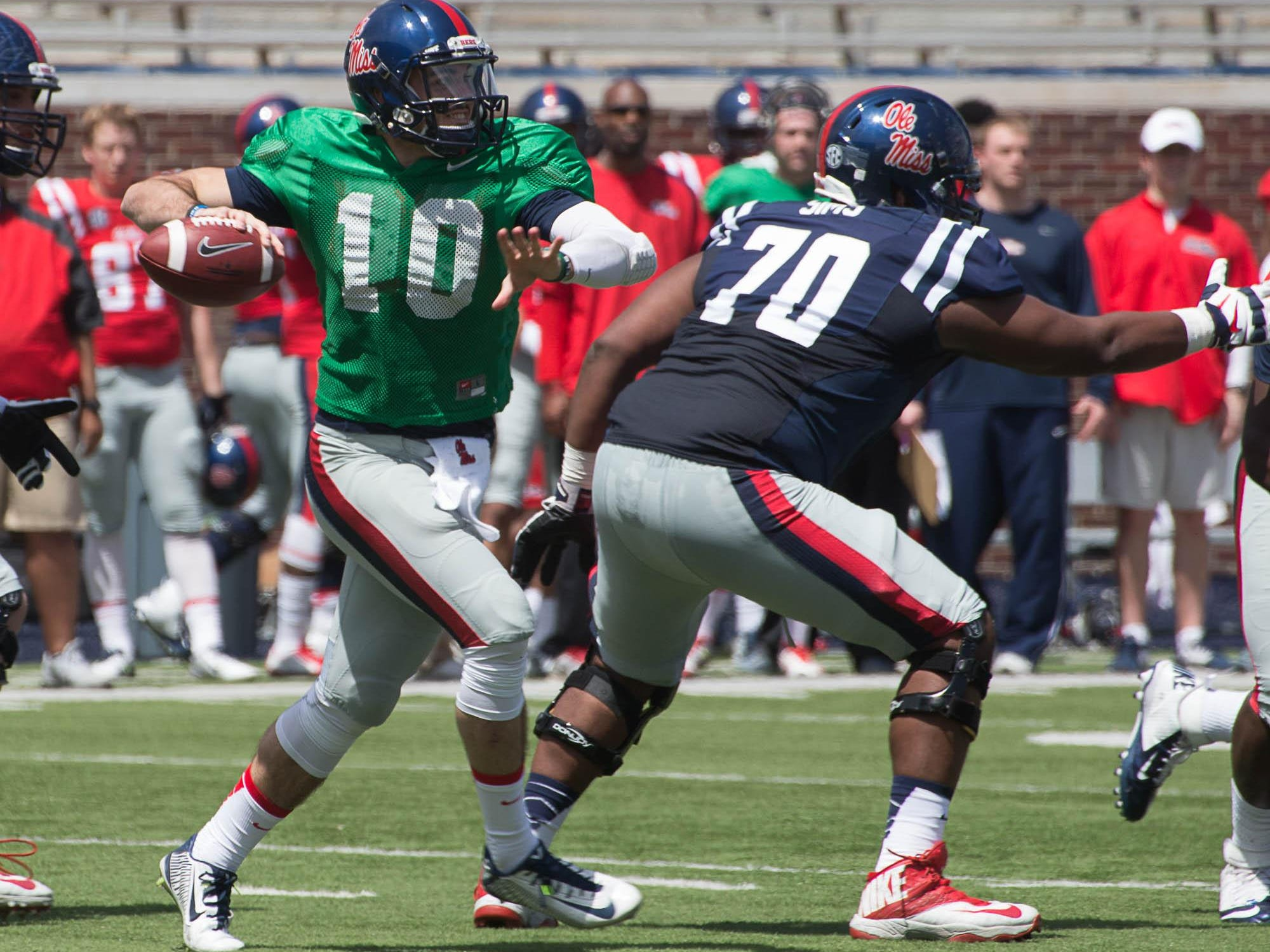 Ole Miss transfer quarterback Chad Kelly is fighting to be named the starter this season, and likely has the edge in athleticism.