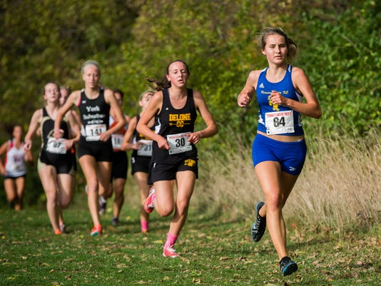 Kennard Dale's Kayla White, right, leads a pack on the course during the YAIAA Cross Country Championship meet at John C. Rudy Park on Tuesday, Oct. 14, 2014. White finished first in 19:25.22. (Photo by Jeff Lautenberger - For GameTimePA.com)