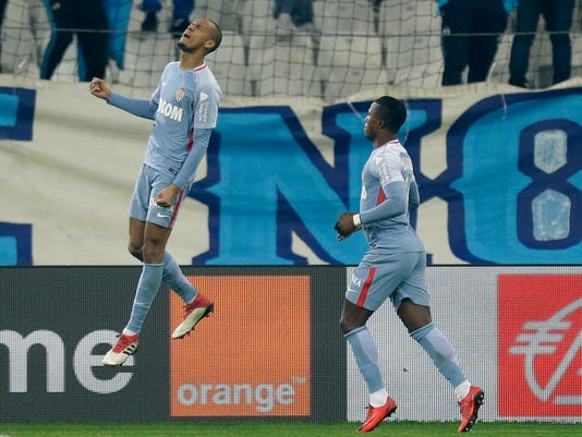 Monaco's Fabio Henrique Tavares Fabinho, left, reacts with Keita Balde, after scoring during the League One soccer match between Marseille and Monaco, at the Velodrome Stadium, in Marseille, southern France, Sunday, Jan. 28, 2018. (AP Photo/Claude Paris)