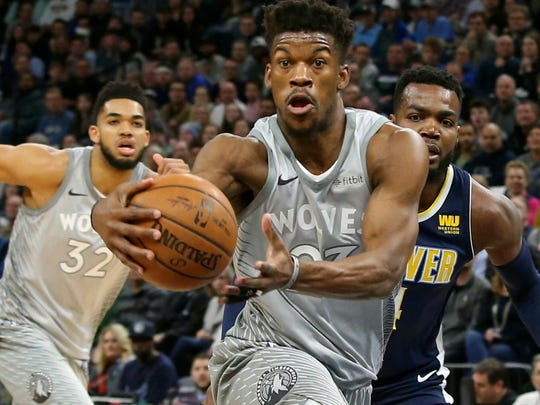 FILE - In this April 11, 2018, file photo, Minnesota Timberwolves' Jimmy Butler drives to the basket ahead of Denver Nuggets' Paul Millsap, right, during the first half of an NBA basketball game in Minneapolis. Butler isn't the first NBA star to ask for a trade, nor will he be the last. But it's far from guaranteed that even if he succeeds in forcing Minnesota into making a move he'll wind up in a place he wants. (AP Photo/Jim Mone, File)