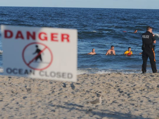 Emergency personnel search the ocean at the 9th Street beach in Ocean City Sunday evening after a 14-year-old boy was reported missing around 6:30 p.m., according to reports. The search was called off as darkness fell around 8:30 p.m.; the victim had not yet been found. Curt Hudson/For the Courier-Post Emergency personnel search the ocean at the 9th St. beach in Ocean City, NJ Sunday evening after an after-hours swimmer was reported missing around 6:30 p.m. The search was called off as darkness set in around 8:30 p.m. with the victim not found. There were several signs on the beach declaring its closure, and a banner on the dune stating the closing times. There apparently were still several hundred people on the beach when this occurred. Photo / Curt Hudson