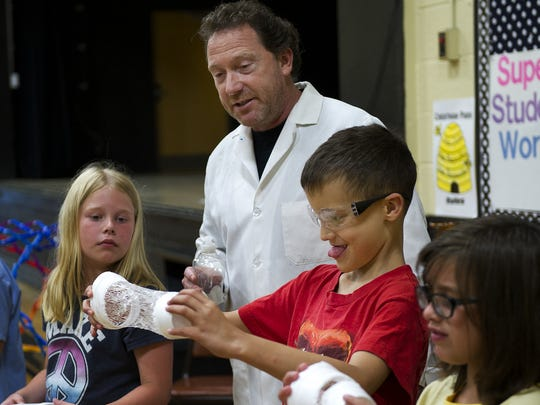 Keith Trehy, aka Mr. Bond the Science Guy, shows young scientists what happens when you pour acetate on a Styrofoam cup during one of hits science edutainment shows. He and his team have dozens of shows at libraries and other locations this summer.