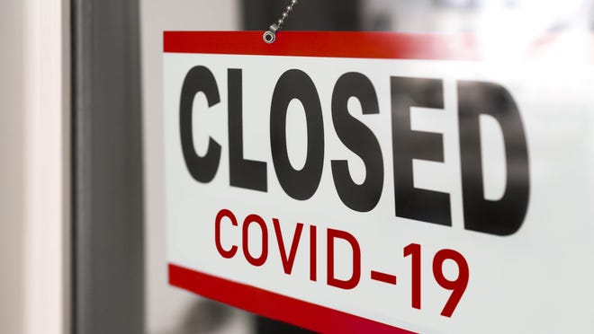 Sign on door reading Closed COVID-19