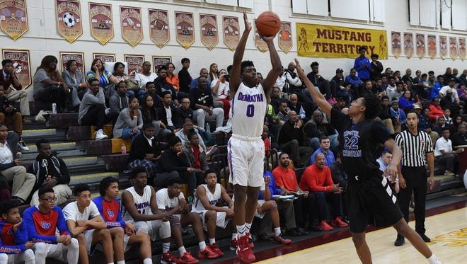 DeMatha guard Ryan Allen shoots a three-pointer during the Maryland Private School Basketball Tournament Championship game against Capitol Christian on March 7. DeMatha won  101-77.