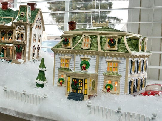 A holiday town is set up on a window sill.