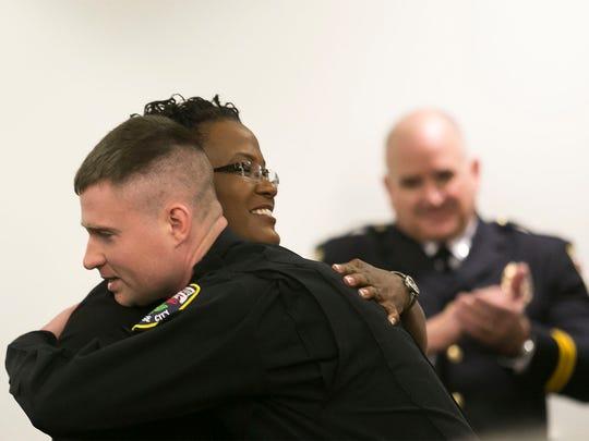 Officer Sean Haggarty, hugs, City of York Mayor C.