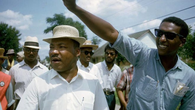 Rev. Martin Luther King, left, and Stokely Carmichael are seen near the end of the 1966 March against Fear. On the second day of the 220-mile walk from Tennessee to Mississippi, organizer James Meredith was shot. He survived and is still alive.