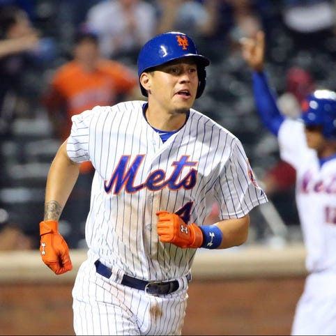 May 26, 2015; New York City, NY, USA; New York Mets shortstop Wilmer Flores (4) heads out on his walk off single during the tenth inning against the Philadelphia Phillies at Citi Field. New York Mets won 5-4 in ten innings. Mandatory Credit: Anthony Gruppuso-USA TODAY Sports