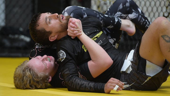 Jaya Haggerty practices jiujitsu with A.J. Trefonas at Trials MMA gym on Tuesday. Haggerty, a 15-year-old from Timnath, travels around the country competing in events.