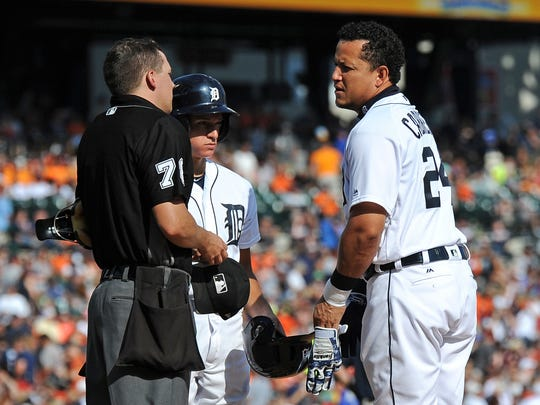 Tigers' Miguel Cabrera argues a call with home plate umpire Adam Hamari after striking out with the bases loaded against the Dodgers in the third inning at Comerica Park on Aug. 19, 2017.