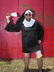 "Nate Runnels dressed as a nun. ""I absolve your sins."