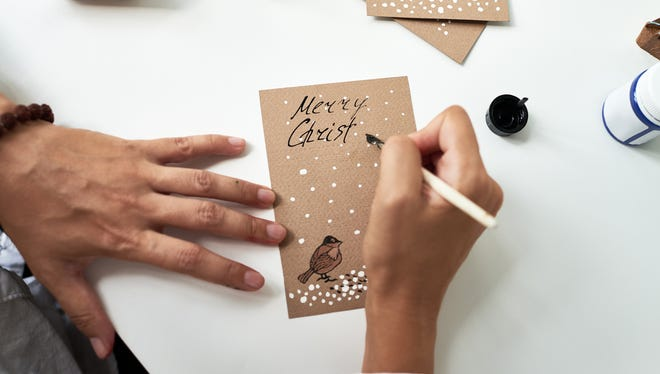 Handwritten holiday cards are still very much alive and appropriate, etiquette experts say.