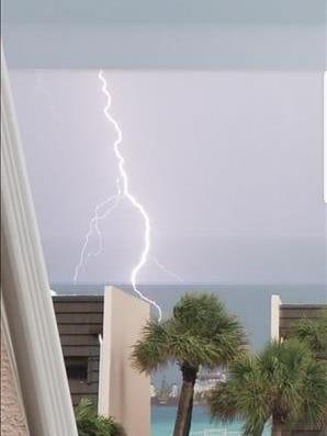 Lightning strikes at the ocean in Jensen Beach. A lightning strike blew out a transformer in Stuart on Thursday, Aug. 9, 2018.