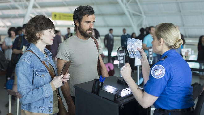 """Carrie Coon (left) and Justin Theroux play two people looking for answers after a rapturelike event leaves them and millions more behind in HBO's """"The Leftovers."""""""