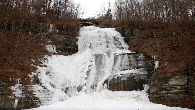 Ice decorates the rock face of Shequaga Falls in Montour Falls Friday, January 29. Despite the large ice formations on the 156-foot facade, water flowed from the top to a mostly frozen basin beneath. Temperatures rose to the low 30s on the cloudy day, but a forecast predicts temperatures to hover in the high 40s before dropping down to the mid-30s by Thursday. The falls are accessible year-round at the end of West Main Street in the village.